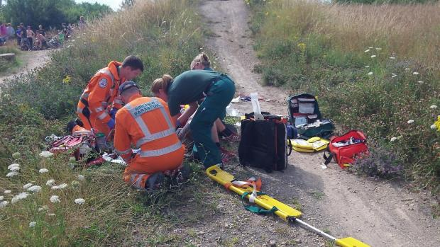 EMERGENCY AID: The teenage boy receiving treatment at the scene