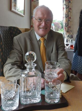 DEDICATION REWARDED: Peter Sotheran was presented a set of engraved glassware as a token of the thanks of the trustees and residents of the almshouses after 24 years on the board