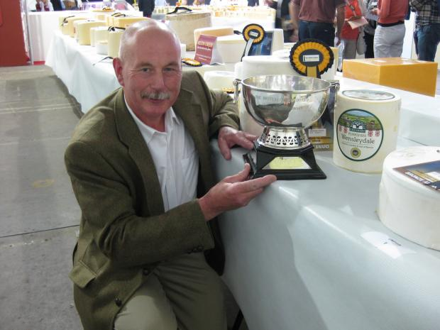 CHEESE EXPERT: Norman McCallum with his award.