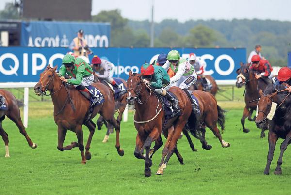 OUT IN FRONT: Heavy Metal (centre) ridden by Joe Fanning wins the Longines International stakes during the King George Day at Ascot last Saturday – coming 12 months after Fanning rode Johnston's Galician to victory in the same race
