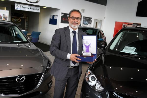 Nas Khan owns the Jennings motor group and has raised money to build a village for flood victims in Pakistan. He is holding the humanitarian award which was presented for his efforts
