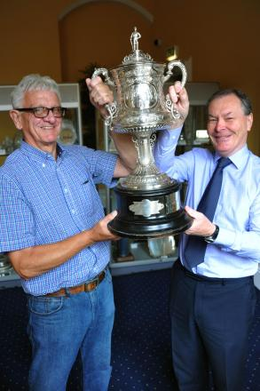 Cleveland Cricket League's chairman, Peter Lodge, with former teammate Deputy Mayor of Middlesbrough, councillor Dave Budd and the Cleveland Cup .