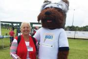 SCHOOL SPORT: Hambleton District Councillor Bridget Fortune with the games mascot