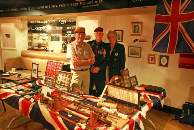 WAR MEMORABILIA: John Philpott, Norman Horton and Joyce Santon from the Darlington Veterans Club host a WW1 exhibition in Binns.Picture:SARAH CALDECOTT