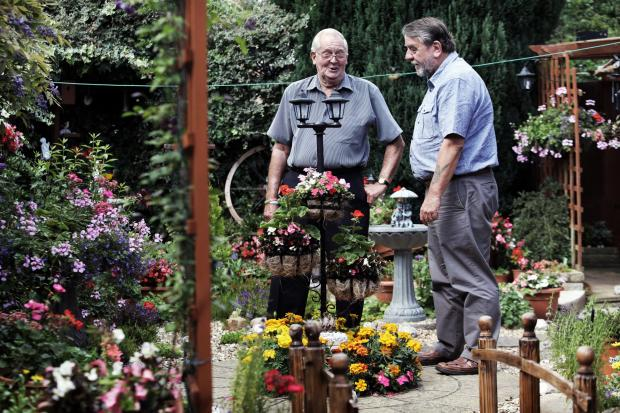 FLOWER POWER: Dennis Woodcock in his garden with Darlington council's Bill Dixon Picture: STUART BOULTON