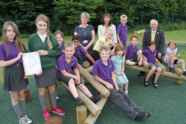 CLASS ACT: West Park Academy headteacher Catherine Thompson, left, with Councillor Cyndi Hughes and ACT Council member Alun Davies with pupils on their new trim track