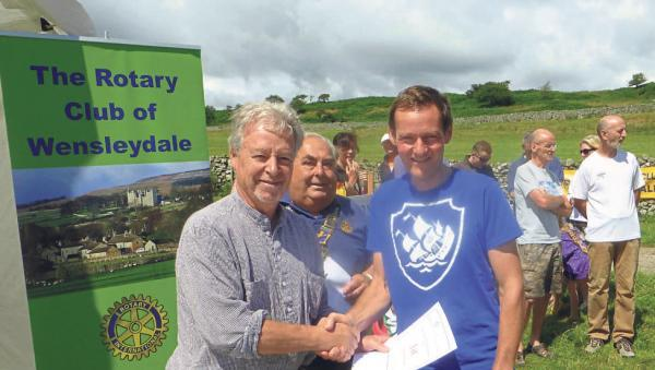 FASTEST: Jim Wight presents first prize to overall winner Mike Jefferies, of Grinton