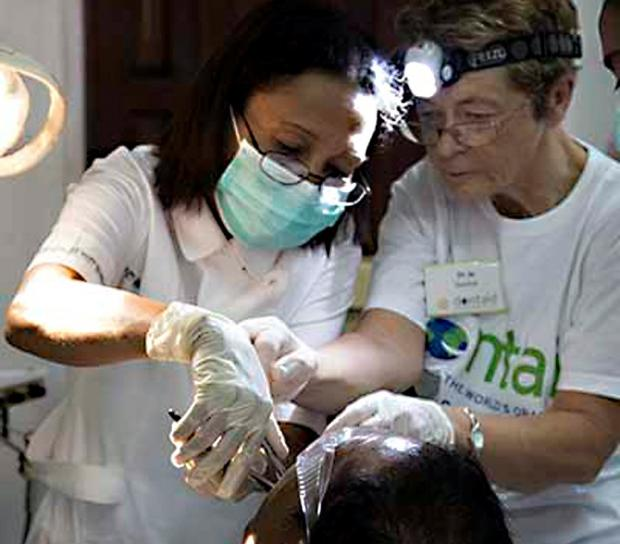 HELPING HAND: Jo Daly, right, during her visit to Timore Leste with the charity Dentaid