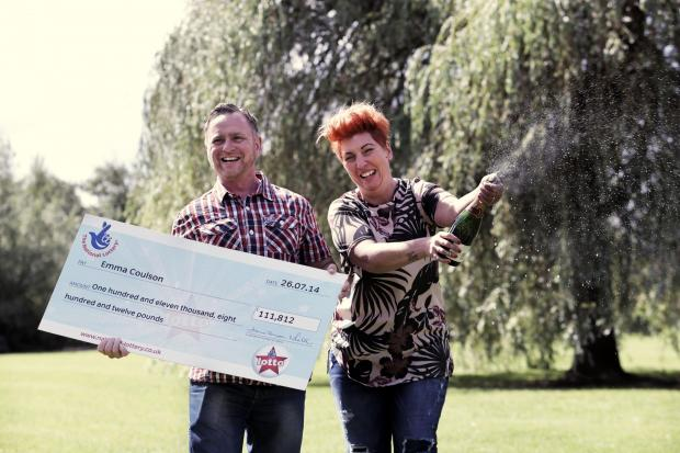 LOTTO WIN: Emma Coulson and Robert Silcox celebrate their lottery success. Picture: STUART BOULTON