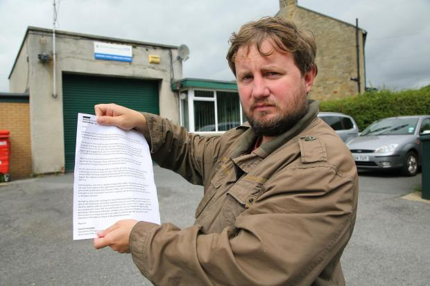 Councillor Tom Deacon pictured outside Barnard Castle Ambulance Station with the leaked email. Pic :Keith Taylor