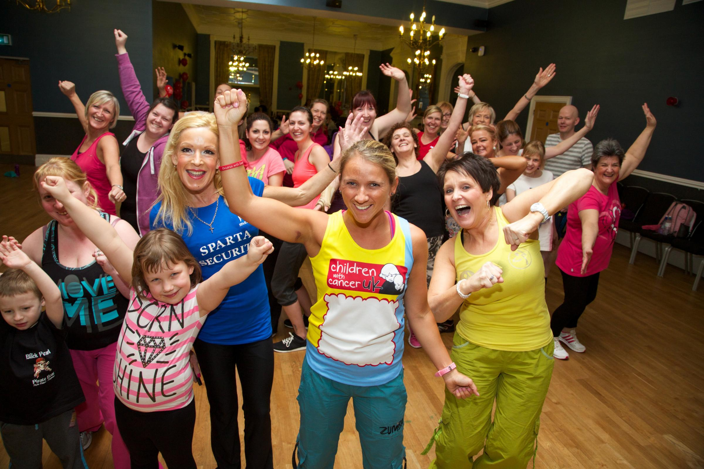 CHARITY FUN: Gillian Clason (centre) pictured at the start of her previous zumbathon in March