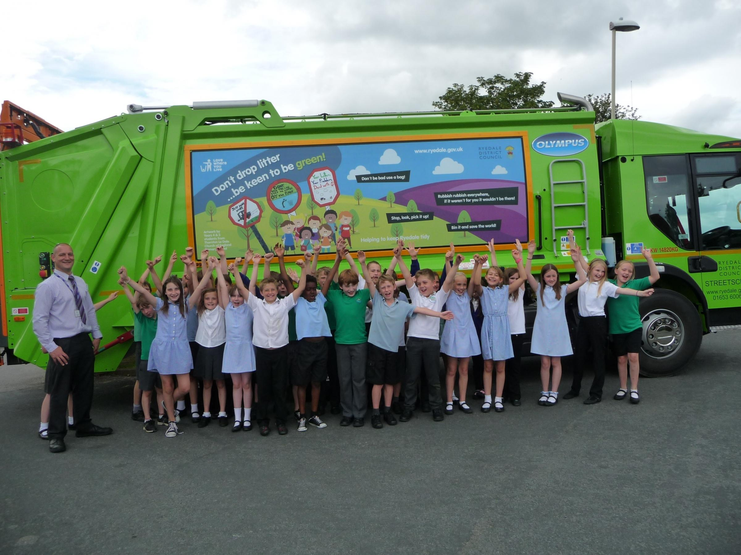 CLEAN UP: Teacher Dave Cash and pupils from Thornton le Dale primary school showing off their artwork design on the side of a waste collection vehicle.