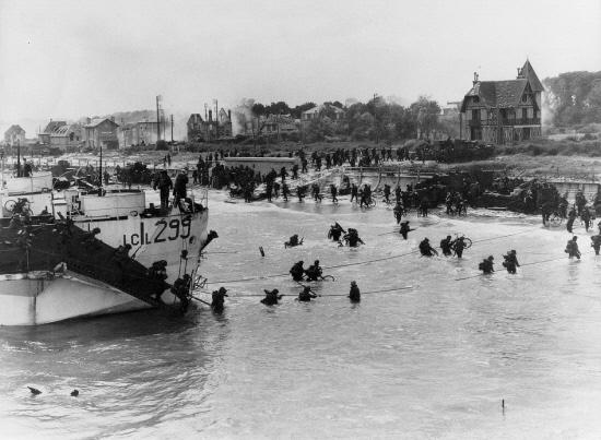 D-DAY RECALLED:Troops make their way up the Normandy beaches while facing heavy fire in June, 1944.