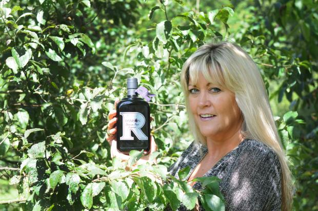 ORCHARD HARVEST: Julia Medforth, of Raithorpe Manor Fine Foods, with a bottle of the award-winning damson port