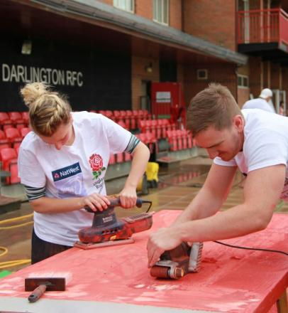 TRY HARD: Volunteers get their hands dirty at Darlington Rugby Club Picture: DAVID BRIDGEN/CLIQUE IMAGES
