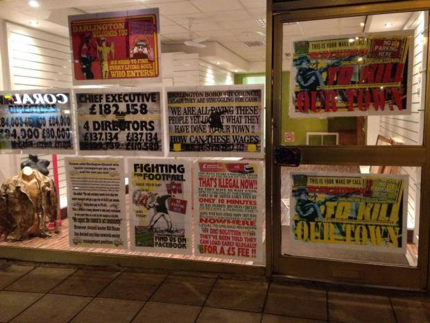 UNITED FRONT: Posters in the front window of DLA headquarters