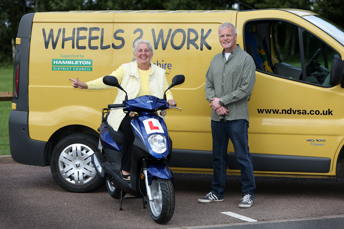 WORKING WHEELS: Cllr Bridget Fortune is pictured with Keith McDonnell from W2W.