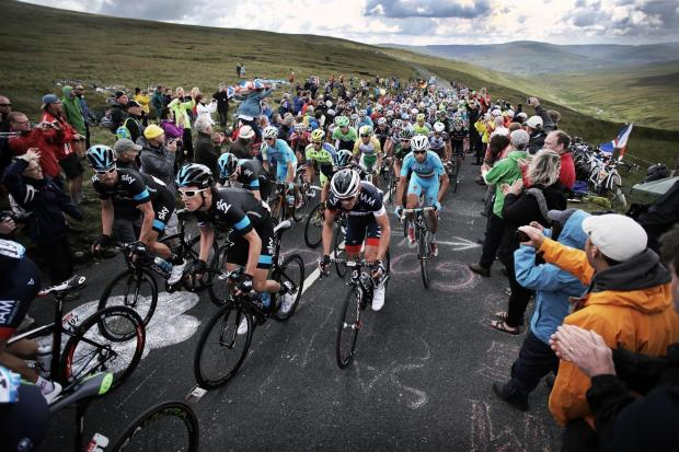 LE TOUR: Chris Froome and his Sky teammates pictured earlier in the day at the top of Buttertubs Pass in the Yorkshire Dales. Picture: STUART BOULTON.