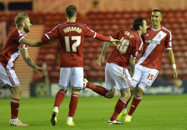 MAN OF THE MATCH: Lee Tomlin wheels away after scoring Middlesbrough's first goal against Preston