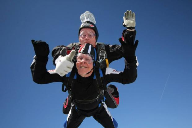 INTO THE BLUE: Military veteran Norman Horton during his sky dive with a Skydive St George team member Picture: SKYDIVE ST GEORGE/BLAIR STENT AND DANNY ROWLANDS