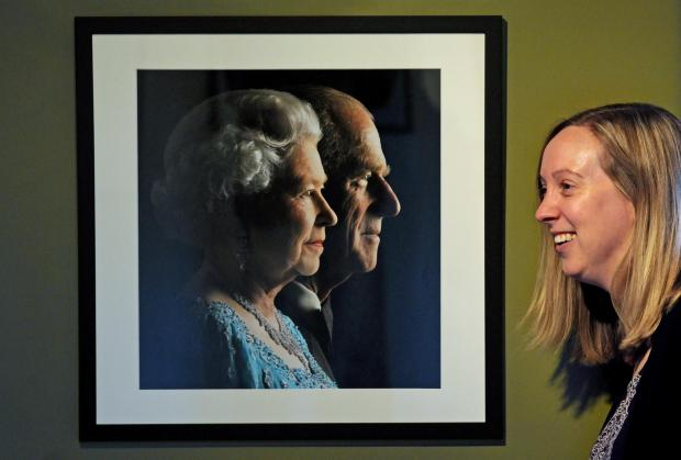 ROYAL PICTURES: Clare Fletcher, at Beningbrough Hall, with one of the photographs from the exhibition of Lichfield works she has curated.