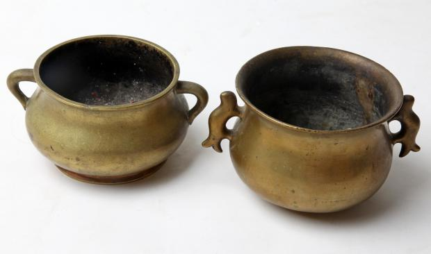 TOP PRICE: Two 19th Century bronze dings, which are believed to be have been brought to England from China by Reverend Jonathan Lees, an eminent missionary