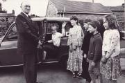 July 1979 and the end of the school year and Bobby Hutchinson, aged 73, is retiring from his job driving children to Gunnerside school from their remote Swaledale farmsteads. The children are not identified on our picture. Who are they? Let us know