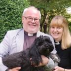 Darlington and Stockton Times: REACHING OUT: Ian and Linda Robinson, with Tibetan terrier, Ozzy, in the garden of the Bedale Rectory