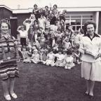 Darlington and Stockton Times: FROM OUR ARCHIVE: In July 1980 there were two retirements at Romanby Primary School, Northallerton, and long-serving teachers Mary Hebdon, left, and Eva Turnbull are pictured with their retirement gifts and the school's pupils who will now be aged in