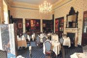 GRAND ROOM: The Library restaurant is a pleasant and formal place to dine, with views of parkland and roaming deer