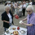 Darlington and Stockton Times: HAPPY DAYS: GOLD members Audrey Lax, left, and Jean Thurkettle prepare for a tea dance in 2012