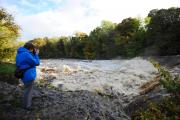 FORCE OF NATURE: A walker stops to take a photograph of the swollen River Ure at Aysgarth Falls, much mentioned in old guides to Yorkshire