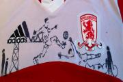 SCORE: A personalised Middlesbrough FC home shirt is being sold to raise money for charity.