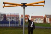 Councillor Paul Beck alongside the play equipment which has been the target of thieves