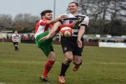 ON THE DEFENSIVE: Liam Hatch challenges for the ball during Darlington's 5-1 win at Harrogate RA last Saturday. Picture: TIM HICKMAN