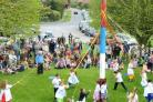 Pupils at Slingsby county primary School dance around the maypole on the village green.Picture: Nigel Holland