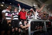 HIGH TIMES: Darlington players and Martin Gray celebrate promotion last Saturday. Picture: CHRIS BOOTH