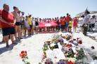 MEMORIAL: An act of remembrance on the beach in Sousse, the scene of the bloody massacre on Friday
