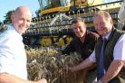 Rod Smith with his Agrii agronomists, Andrew Wallace (left) and Eric Horsburgh (right) and the winning crop. (53642863)