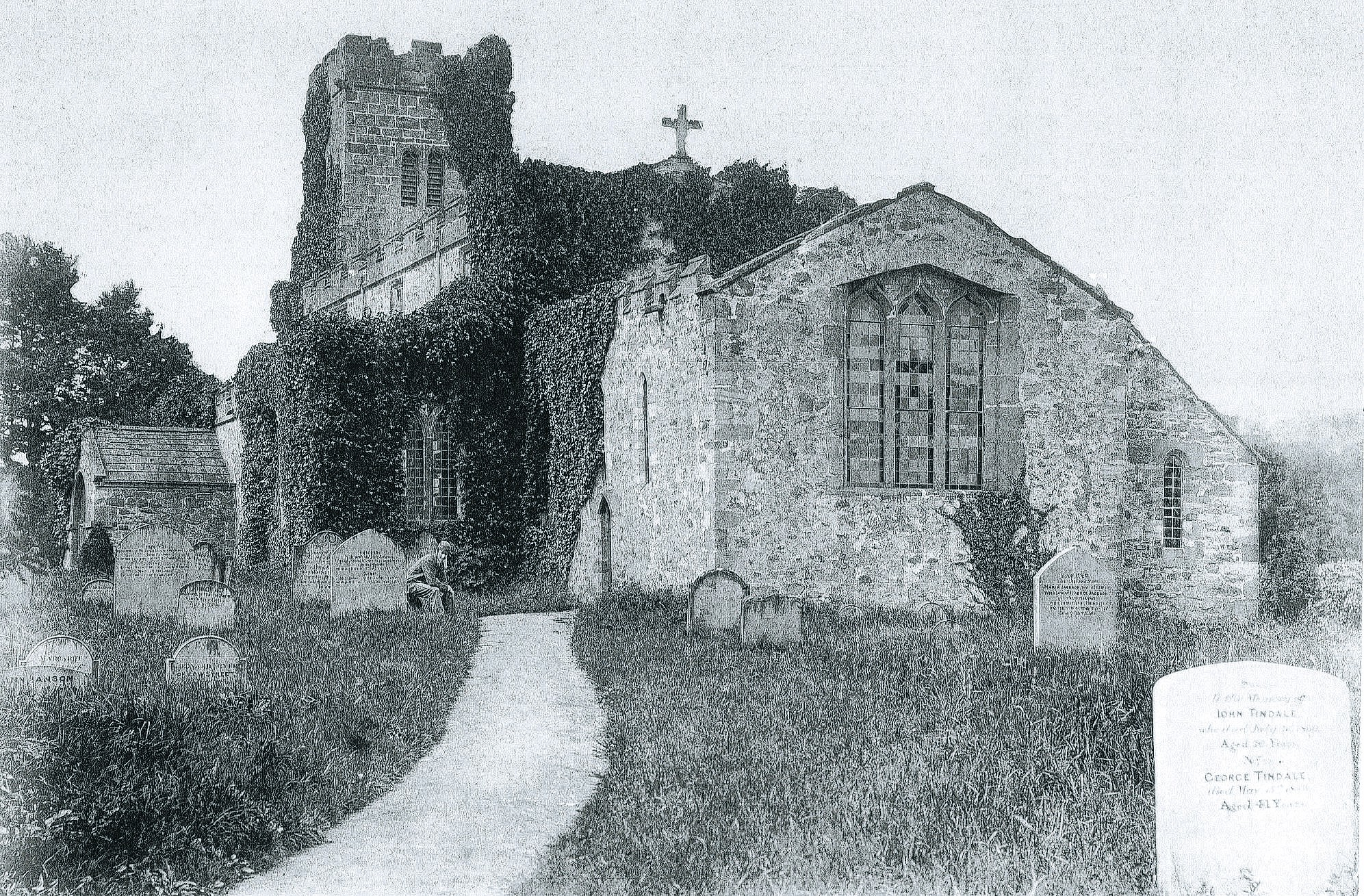 A very early photo of St Radegun's Church, Scruton, before it was rebuilt in 1864. Can you see the chap sitting by the porch?