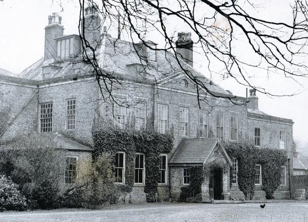 Darlington and Stockton Times: Scruton Hall, built in 1705 by Roger Gale, MP for Norhallerton, and demolished in 1956 although its Lebanon cedars remain in the field behind the church (55062527)