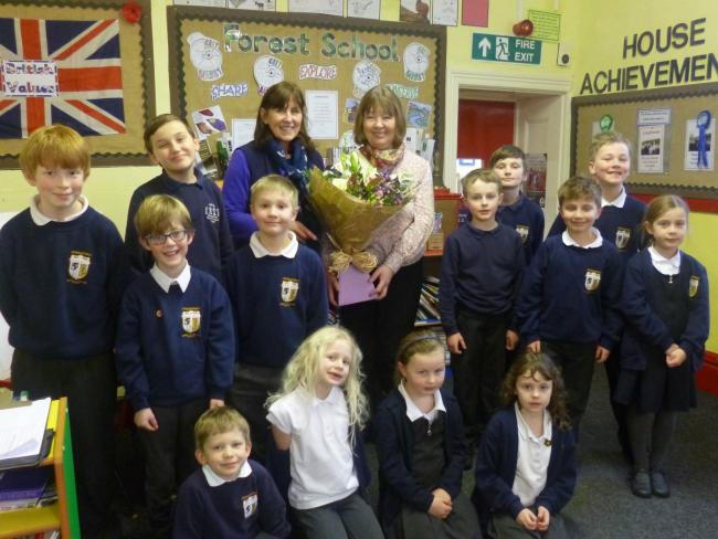 CELEBRATE: Arkengarthdale School pupils with Barbara Birks (left) and Kath Hollingworth (right)