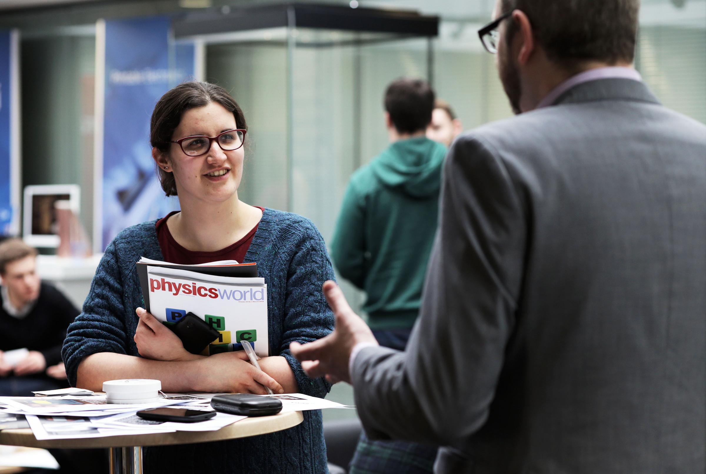 Durham University physics student Lara Small networking with Dr Adam Tuff, a nuclear physicist at Kromek Ltd, during the event. Picture: Stuart Boulton.
