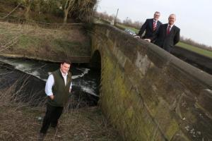 Hambleton District Council leader Cllr Mark Robson with Roy Fishwick, of Cleveland Steel and Tubes and Martin Kelly from Severfield beside the humpback bridge near Dalton Industrial Estate