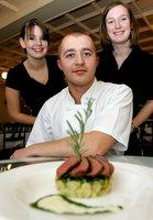 HOME PRODUCE: waitresses, and sisters, Leah Stephenson, 16, and Hannah,. 20, with Bowes Museum chef Ben Parnaby with his dish using mutton from their parent's farm