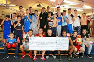 CHAMPIONS:  Corporate Personal Fitness's John Harrison (front, third form left) presents a cheque to Andy Marksby (front, fourth form left) watched by members of Darlington Amateur Boxing Club