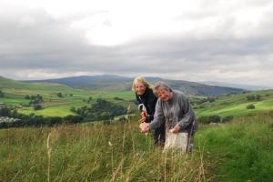 WILDFLOWER: Tanya St. Pierre (left) and Margaret Barker, secretary of St Oswald's Parochial Church Council in Horton-in-Ribblesdale, who will be creating a mini wildflower meadow in the churchyard four miles away