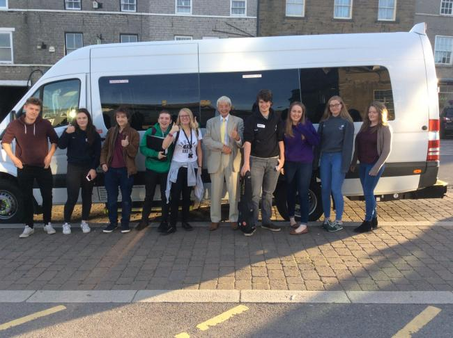 County Councillor John Blackie and Queen Elizabeth College students with the Little White Bus's brand new Mercedes Treka 16 seater, brought out especially for the first day of the bespoke Leyburn to Hawes service