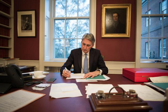 Chancellor of the Exchequer Philip Hammond reads through his Autumn Statement in his office. Picture: Stefan Rousseau/PA Wire
