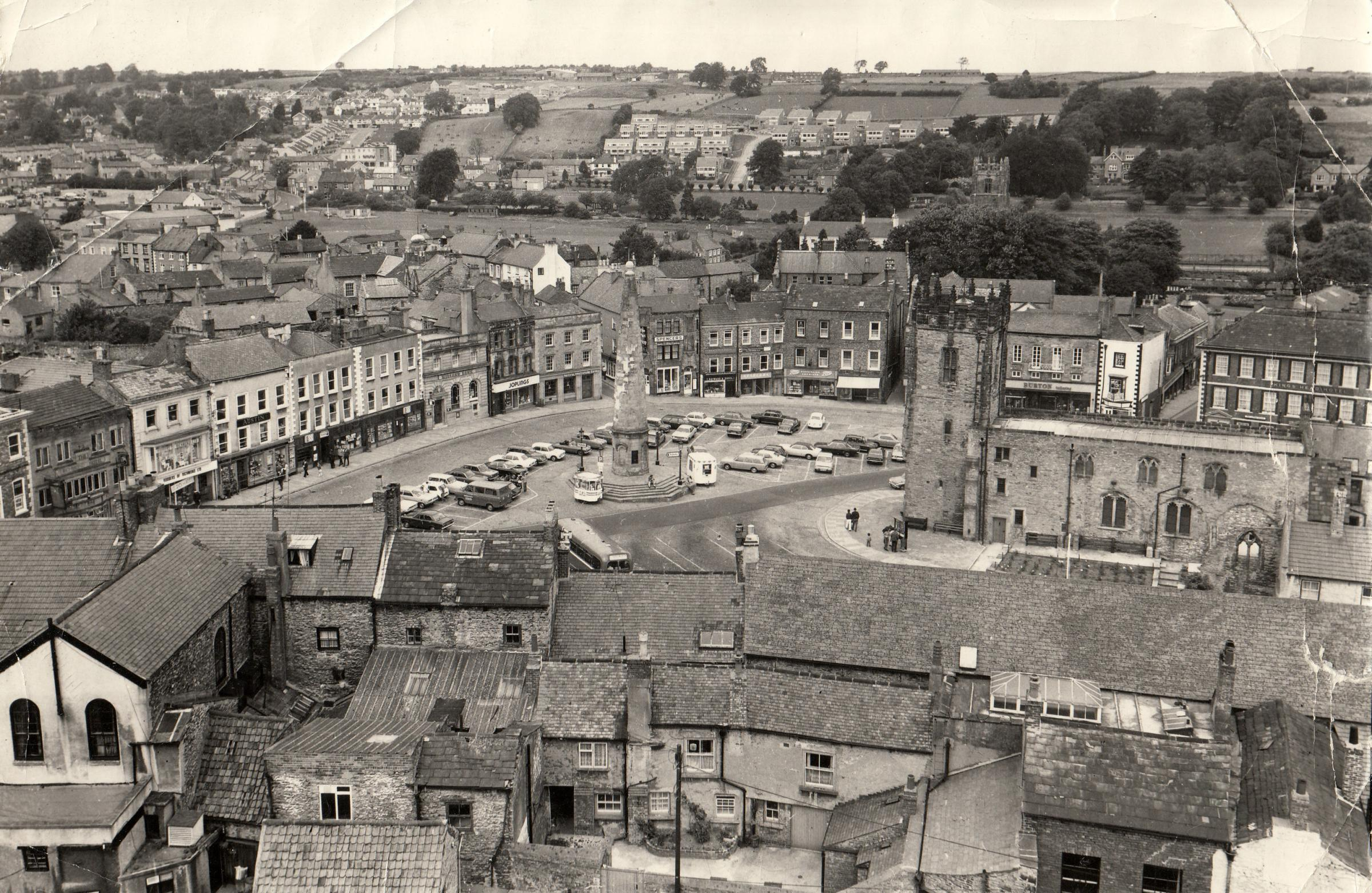 Richmond Market Place from the castle in August 1974, with the 1771 obelisk that was erected over a 12,000 gallon reservoir. The cricket club only has a small wooden pavilion, and the houses of Prior and Bolton avenues are just being built on the hillside